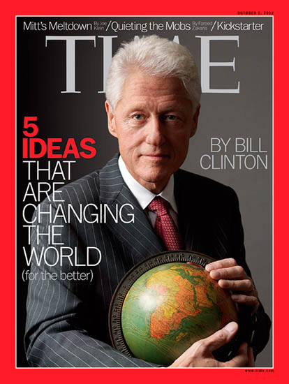 Bill Clinton holds a Bill Glazer Globe for Time Magazine