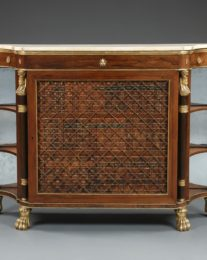 A Superb Pair Of Regency Rosewood Library Cabinets With Giltwood Detailing And Faux Book Panels