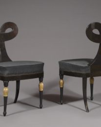 Pair Of Ebonized And Partially Gilded Side Chairs Of Unique Form