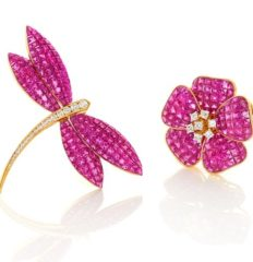 Pair of invisibly set ruby and diamond brooches