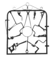 A Garden Gate In Wrought Iron With Antique Farm Tools